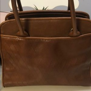 A pocketbook by Etienne Aigner genuine leather